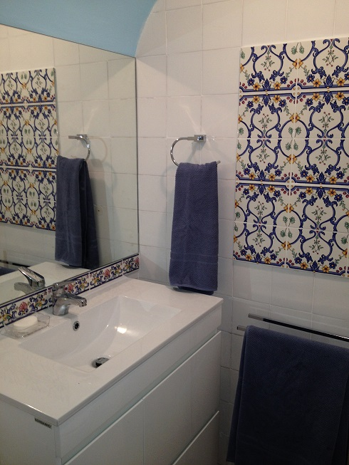 Portuguese Azulejo tiles have been discretely sprinkled through the apartment.
